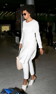 White on trend: Solange Knowles is the latest star to arrive in Paris as the world prepare...