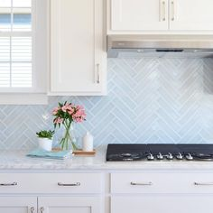 Young House Love | Lovely blue herringbone tile, marble counters, white cabinets.