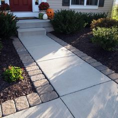 Adding pavers around a standard concrete walkway can give your entrance a little something extra.