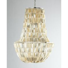 """Metal frame adorned with layers of capiz shell and plastic beads. Uses six 60-watt bulbs. 4.5""""Dia. ceiling canopy included. Direct wire; professional installati..."""