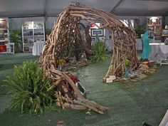 Would be a fun long term activity for children to play with natural materials and play in it after!
