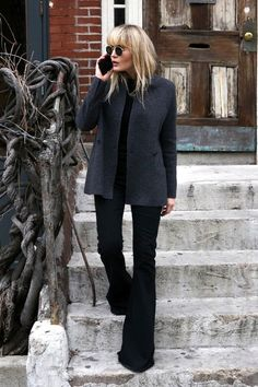 A Minimalist Cool Way to Wear Black Flares via @WhoWhatWearUK