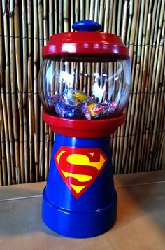 Customized/Personalized Superhero  Inspired Gumball Machine Candy Jar.   Can be used for candy, nuts, change, beta fish, q-tips, cotton balls, hair pins or anything you can think of.  Visit Julie's Kraft Shack @ https://www.facebook.com/JuliesKraftShack