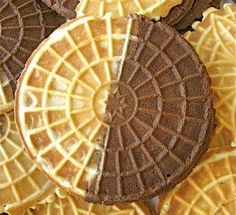 Pizzelle with pizzazz! Our Nonnie would make stacks on a single, 2-sided cast iron press; mostly anise, sometimes almond or lemon. Here is a recipe for half chocolate. Yummm!