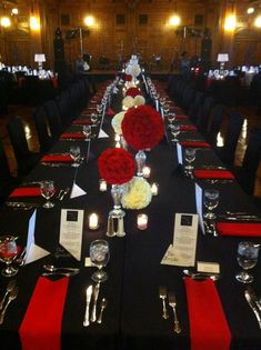 Red Satin Napkins accent the Black Table Linens and Black Chair Covers