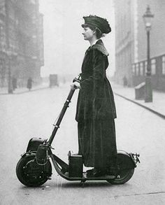Lady Florence Norman a suffragette on her motor-scooter in 1916. Travelling to work at offices in London where she was a supervisor. The scooter was a birthday present from her husband, the Journalist and Liberal politician Sir Henry Norman.