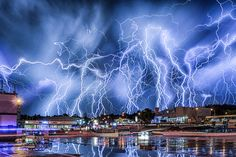 Lightning bolts illuminate the sky in a near-Biblical scene, in a composite image made of dozens of photographs, on February 10, 2015, in Johannesburg, South Africa.