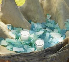 $14.50 SEA GLASS VASE FILLER.  BLUE. Each piece is tumbled for a smooth texture and polished look. 4 pounds of glass...Glowing Sea-Glass Votives..can be created by placing a candle inside a glass holder and setting it in a larger glass vessel, Fill the space between with shards.