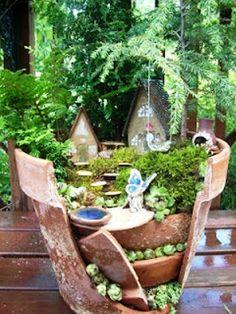 Cute idea for a fairy garden if you have broken pots. #fairygarden #DIY #recycling