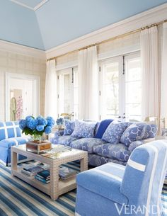 Custom sofa in Osborne & Little fabric. Slipper chairs and curtains in Brunschwig & Fils fabrics. Wallpaper, ...