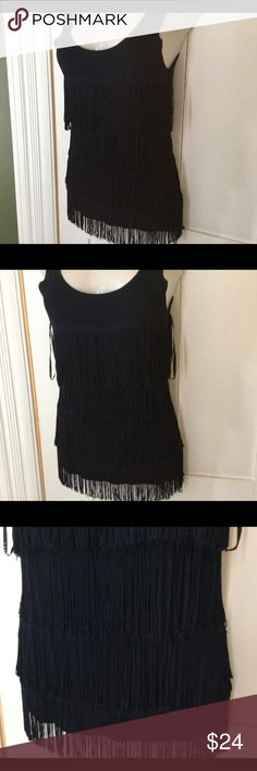 Cyrus dark blue fringe blouse medium, sassy Love this. Low scoop neck line and fringe in layers that moves subtly when you do. It's dark blue, almost bluish black and kinda of heavy. The layers of fringe are no joke! Worn only to try on. Cyrus Tops Blouses