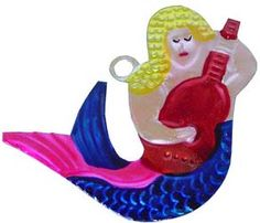 #Christmas #Mexico #FelizNavidad #ornament  This colorful tin mermaid ornament was hand punched and hand painted in Oaxaca, Mexico.  A funky and whimsical addition to your Christmas tree, and a neat collectible, too!  Each ornament is painted on both sides, and has a hole in the top where a string can be attached for easy hanging.