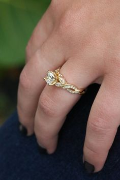 """A near-colorless (""""J"""" color) Cushion cut diamond pairs perfectly with the richness of yellow gold and accentuates the vintage feel of this ring setting."""