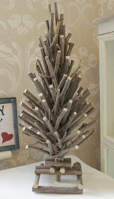 Bring in the cozy & comfy vibe in your holiday home decor. Here are the best Farmhouse Christmas decorations, which are country style Rustic Christmas decor Christmas Decor Diy Cheap, Wooden Christmas Tree Decorations, Christmas Centerpieces, Christmas Projects, Wooden Xmas Trees, Hanging Decorations, Twig Christmas Tree, Twig Tree, Rustic Christmas