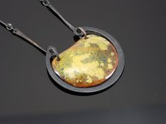 Dawn Lombard, enameled Copper, Copper and Steel pendant, $60.00 on Etsy.