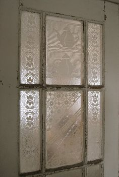 I see this as a great repurposed old window wall hanging from chain