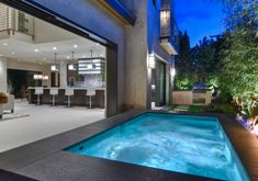 A small backyard looks larger with the addition of a pool and bifold doors. #pool #smallbackyard #modernbackyard