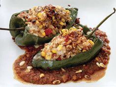 Mexican Stuffed Capsicums - If you love capsicums, this dish gives you a great way to enjoy them—rice, corn, nuts and cheese are loaded into halved capsicums and then baked on top of a zesty chilli and tomato sauce. If you prefer a little less heat, remove the seeds from the chilli first.
