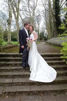 Bride and grrom in the gardens at at The Friars, Aylesford
