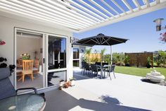 Stacker sliders in both family and dining increase the depth of space as life spills outdoors - Louvretec shelter off family providing protection from sun and rain. The master suite also opens outside to enjoy this sun-drenched garden.