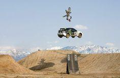 Crazy!  Travis Pastrana doing a kick flip over Ken Block on a dirt bike.