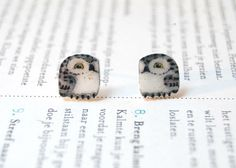 Pair of snowy owl earrings - each earring is individually hand-drawn onto shrink plastic then coated with a gloss medium
