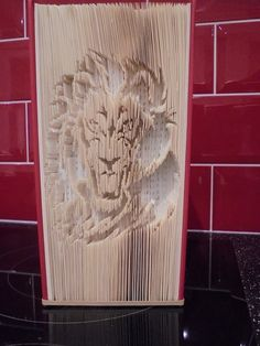 Cut And Fold Book folding pattern of a lion EXCLUSIVE by BookArtCo