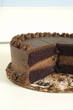 "decadent chocolate cake -Ina Garten's Recipe, similar to ""Black Magic Cake"", with a chocolate mousse filling."