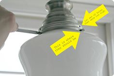 DIY schoolhouse light pendant using canning jar rings and a glass shade from the hardware store.