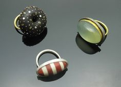 Scarab rings #44, 45 and 46: ebony donut with 18ky gold, sterling silver and copper, green moonstone with 22ky, 18ky, sterling silver, pink ivorywood and bone striped cab with sterling silver. Susan Chin