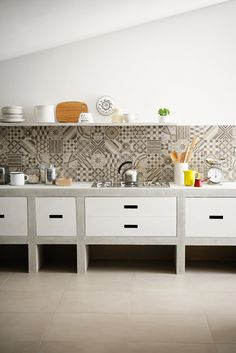 Get some great kitchen design ideas with these creative tile backsplash options that use graphic, bold patterns with a rainbow of color and materials. Cement Tiles Bathroom, Kitchen Backsplash, Diy Kitchen, Kitchen Decor, Backsplash Ideas, Wall Tiles, Travertine Backsplash, Beadboard Backsplash, Herringbone Backsplash