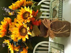 Fall decoration - wrap a vase with burlap, ribbon, and straw and add some beautiful Fall flowers