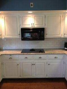 Another kitchen gets a facelift with Pure White Annie Sloan Chalk Paint(tm). The cabinets had previously been painted with cream on the fronts of the doors. They had been sealed with an oil varni…