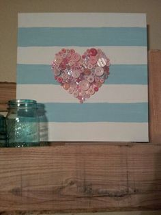 Painted canvas with pink buttons