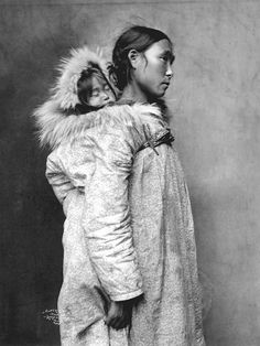 Inuit mother with baby    Image No: ND-1-105    Title: Inuit mother (in parka) carrying baby on her back, Nome (?), Alaska.    Date: 1903