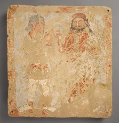 Bactria ca. 3rd C. AD. Terracotta gouache.  rare Central Asian votive panel of supreme deity Zeus / Serapis/Ohrmazd with nimbus,  with a full beard and long wavy hair, who has been identified as the , receives a suppliant in the characteristic Iranian short tunic and leggings. The Intercultural Kushan Style displays: Indian divine iconography;  Iranian type of two-figured composition; and Greco-Roman naturalism in the drapery and pose, the use of light and shadow to suggest modeling.