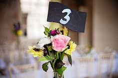 bright table florals and chalkboard table numbers | Ciaran and Louise's perfectly pastel Borris House wedding by Katie Kav | www.onefabday.com