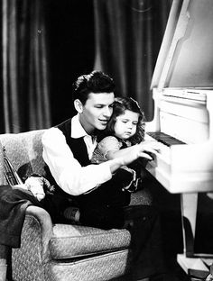 Frank Sinatra and daughter, Nancy. He must be playing, and singing to her ~ ♪ Nancy With The Laughing Face ♪