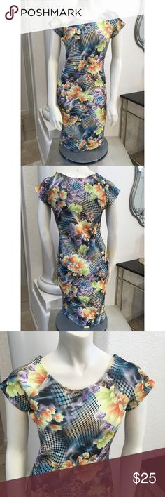 """Lovecrazy dress floral geo print stretch sheath ✨ LoveCrazy ✨ stretch sheath dress   -floral geo print -yellow gold floral on black geo metro pattern  -cap sleeve -95 poly 5 spandex -gorgeous fit -length 38"""", bust 17"""" pit to pit, waist 28"""", hips 34"""". Material does stretch 1-2"""". -size is 6 or S to M adult  Made in USA !  Brand new with tags No trades please 💋 LoveCrazy Dresses"""