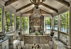 """Rustic Porch with outdoor pizza oven, Wine Barrel Chandelier 32"""", exterior stone floors, Outdoor kitchen, Wrap around porch"""