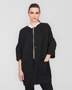 Jaeger dropped should coat  Jaeger London's directional dropped shoulder coat. This collarless style boasts really full sleeves and oversized pockets. Balance the silhouette with skinny jeans or a form-fitting pencil skirt. COLLECTION: London PRODUCT CODE: 590029G-00100-XS £375.00