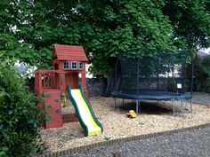 Spacious children's play area with soft bark chip flooring for jumps bumps! Playhouse is included in the sale price