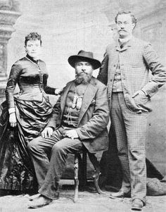 """Gabriel Dumont the statesman with his """"writer"""", E. Riboulet and Mrs. Riboulet (not Madeleine Dumont as sometimes identified), Staten Island, N.Y., 1887."""