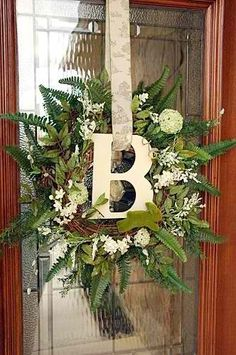Doubled grapevine wreath with artificial greenery that can be used all year long by changing out florals to coordinate with holiday of your choice.