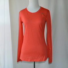 """Nike Dri-Fit Long Sleeve Top Light crimson long sleeve Nike Dri Fit top. Form-fitting and moisture wicking. The perfect athletic top for fall and winter. Small stain on front, shown in photo. Still in great condition!  