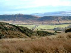 The view from Steel Rigg, on Hadrian's Wall, to Barcombe Hill above Vindolanda. The Roman fort lies just right of the picture.  Northumberland, England.