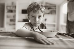 photojournalism, kids portraits, kid photography, children's photos, children's photography, children's photojournalism, little boy, Steve DePino Photography, lifestyle photography, black and white, breakfast