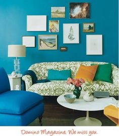 The blue, orange, and green colors all create a triadic color scheme. They look nice together and are equally distant from eachother on the color wheel. This room has a lot going on and the colors give the room movement and excitement.