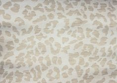 Ocelot Upholstery Fabric Woven fabric in cream and ivory mimicking an ocelots coat