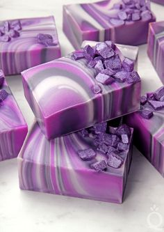 Learn how to create the spin swirl in cold process soap. This Agate Spin Swirl recipe creates beautiful purple swirls that look just like an agate crystal.